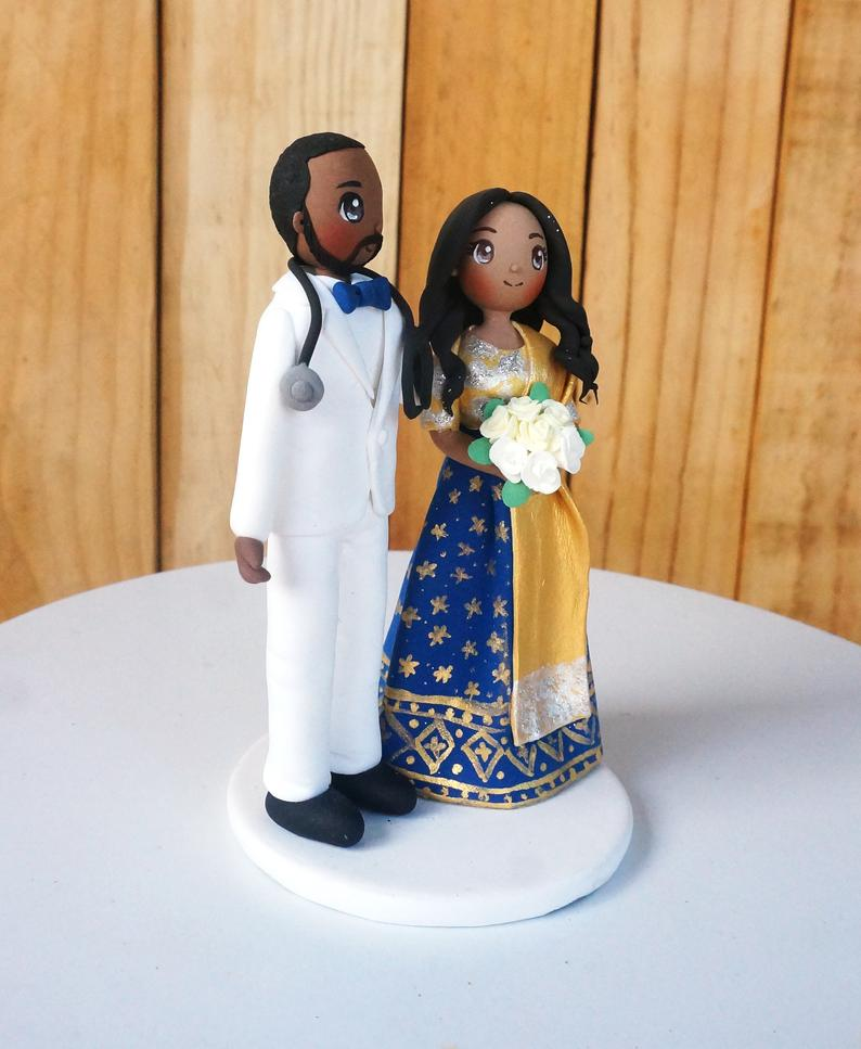 Picture of Indian wedding cake topper in blue wedding