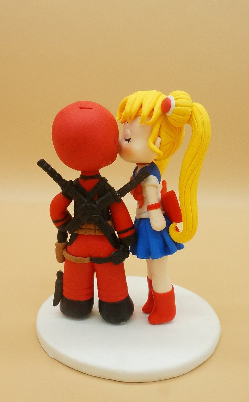 Picture of Sailor Moon and DeadPool wedding cake topper